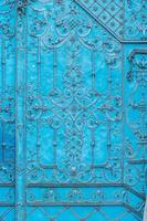 Close up of blue painted richly decorated baroque steel door