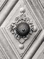 Vintage doorknob on antique door, background