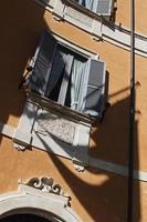 Shadow of flag falling across building facade photo