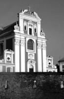 wall and baroque facade of church