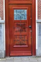 Modern looking brown wooden door photo
