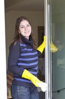 Pretty maid washing house windows