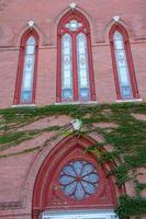 Ornate windows in red brick facade, church, Keene, New Hampshire.