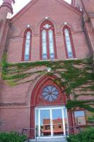 Red brick facade, ornate windows, church, downtown Keene, New Hampshire.