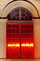 Illuminated historic window in Munich, Germany
