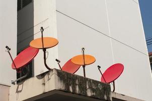 red and orange satellite dishes