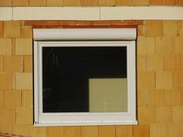 sitio de construcción casa ventana pared de ladrillo vidrio
