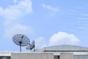 Satellite on top building. photo