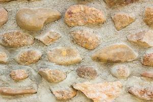 Muro de piedra de mosaico de grunge. foto