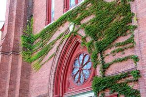 Historic, red brick church with ivy, downtown Keene, New Hampshire.