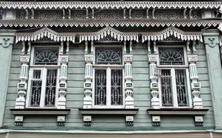 Three windows with architraves photo