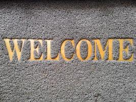 Plastic doormat and golden welcome word photo