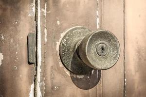 Rustic door knob on the old wooden door.
