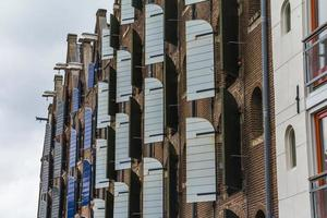 Wooden window blinds on typical Amsterdam houses