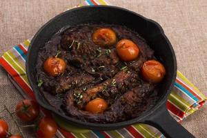 pulpo con salsa de tomate foto