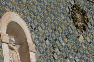 Majolica tiles on the facade of Santa Maria delle Grazie photo