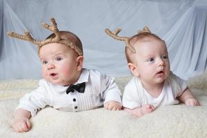 babies with deer horns on bright background