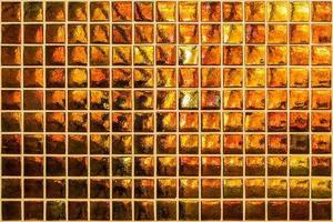 moderno mosaico naranja con pequeños cuadrados foto