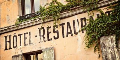 Vintage french hotel sign painted on an old house