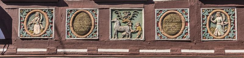 traditional carving at an half timbered house with symbols photo