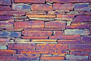 Grunge vintage wall of stone tiles