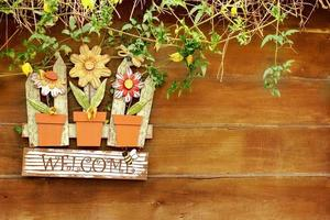 Welcome  signboard on wooden fence in garden photo