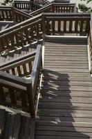 wooden stairs on the beach in Miedzyzdroje