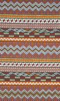 Colorful thai peruvian style rug surface close up.