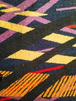 Colorful thai peruvian style rug surface close up