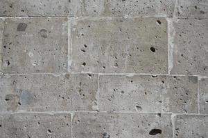 Natural volcanic stone wall background photo