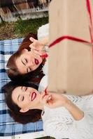 Girls lie and unpacks a gift