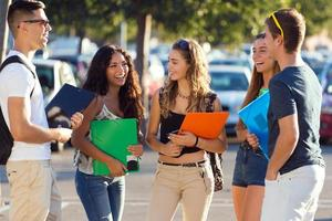 Group of friends talking in the street after class