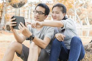 Couple use tablet