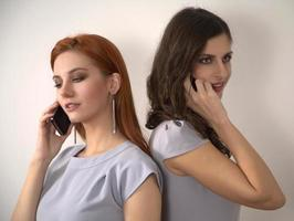 Young women with mobile phones