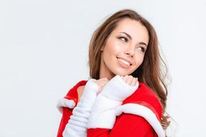 Happy lovely female in red santa claus costume