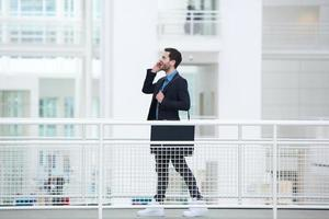 Businessman talking on mobile phone photo