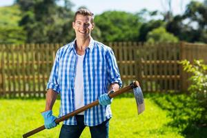 young man with a hoe in garden