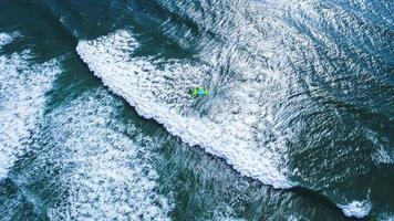 Aerial photo of person kitesurfing