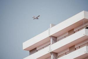 White monoplane over building