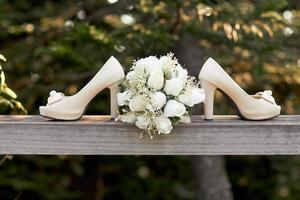 Wedding shoes and bouquet outside