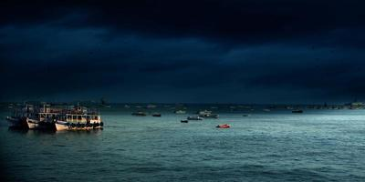 Boats on sea at night photo