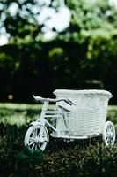 White wicker bicycle outside