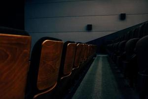Brown wooden chairs in theater