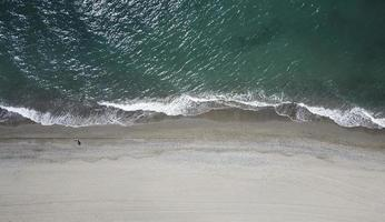 Aerial photography of person on shore photo