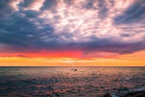 Boat on sea at sunset photo