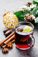 Mulled red wine with apple slices and spices photo