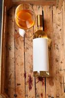 Bottle of white wine photo
