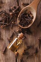 essence of cloves in the bottle macro  vertical top view photo
