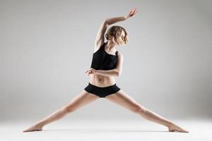 young beautiful woman in black T-shirt and shorts dancing