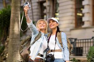 tourists taking self portrait